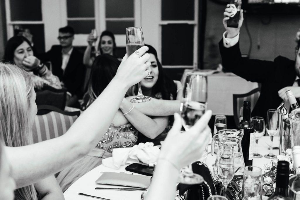 Guests cheers at Oatlands Park Wedding
