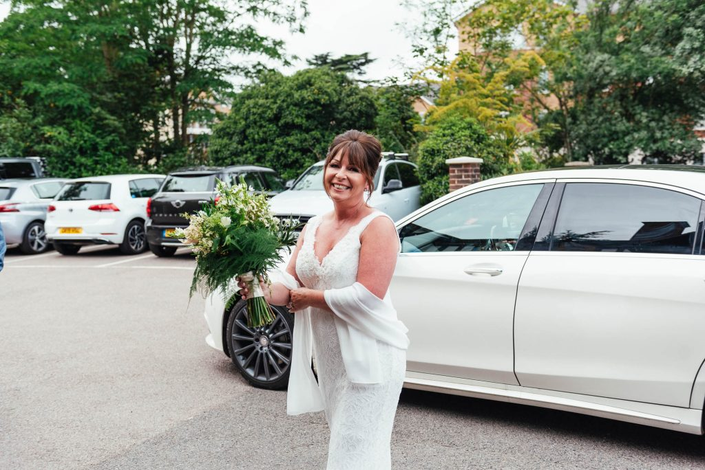 Gorgeous bride arrives at Weybridge registry office