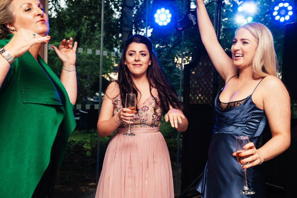 Fun dance floor photography at Oatlands Park wedding