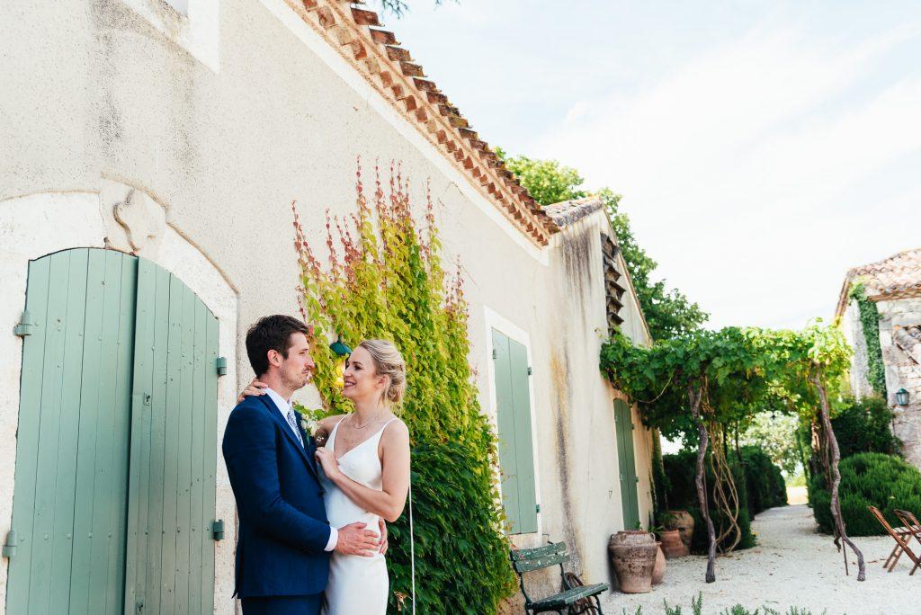 Outdoor French courtyard destination wedding couples portrait