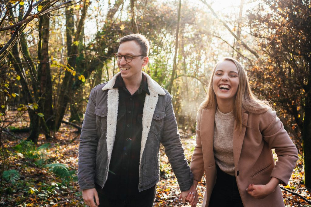 Couple laughing together on documentary engagement photography shoot