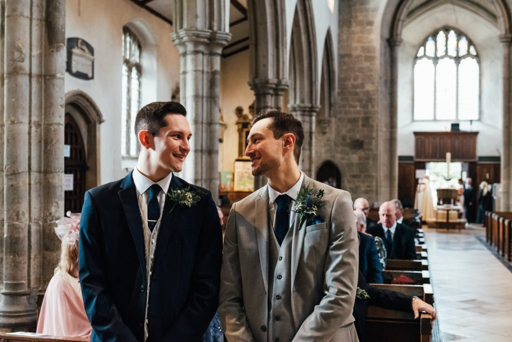 Groom and best man share a smile together, London wedding photography