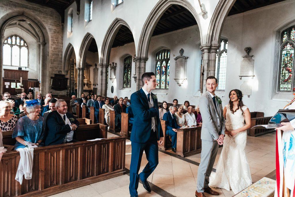 Best man brings the wedding rings to the vicar