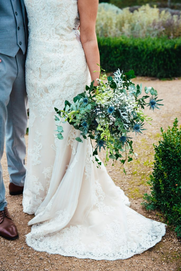 Creative wedding detail photography, wild and free floral arrangement in white and blue tones