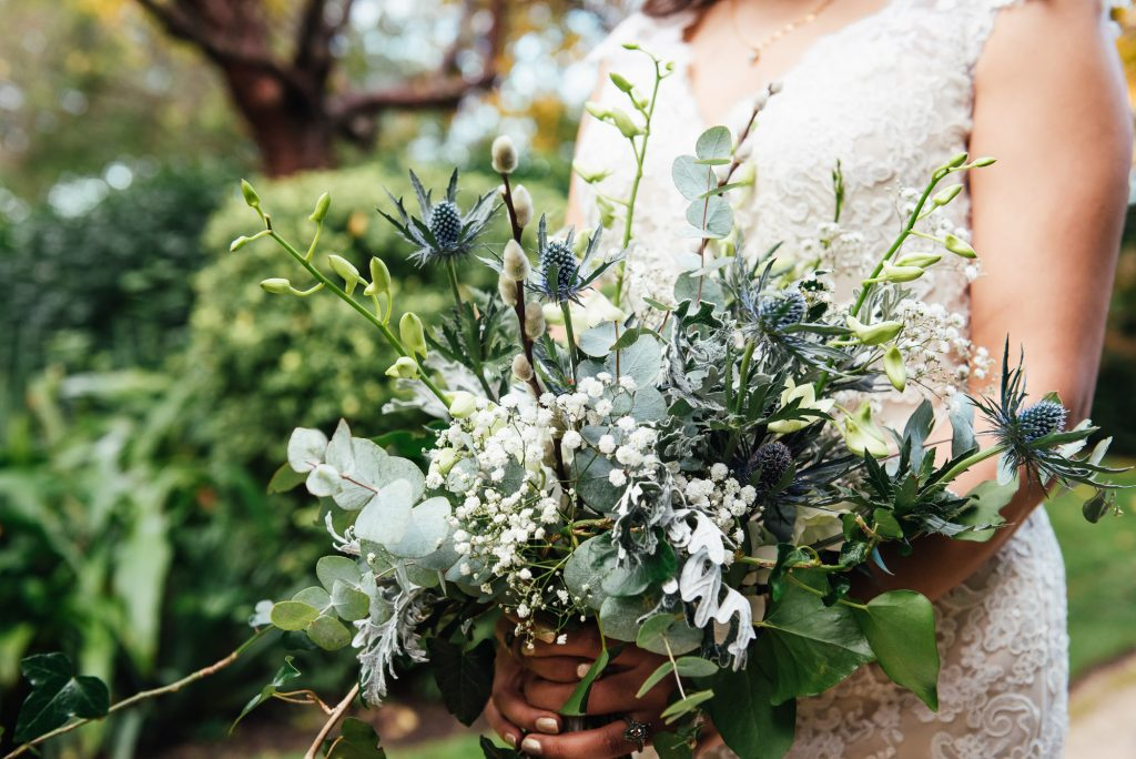Wildflower wedding bouquet with white, green and blue floral tones