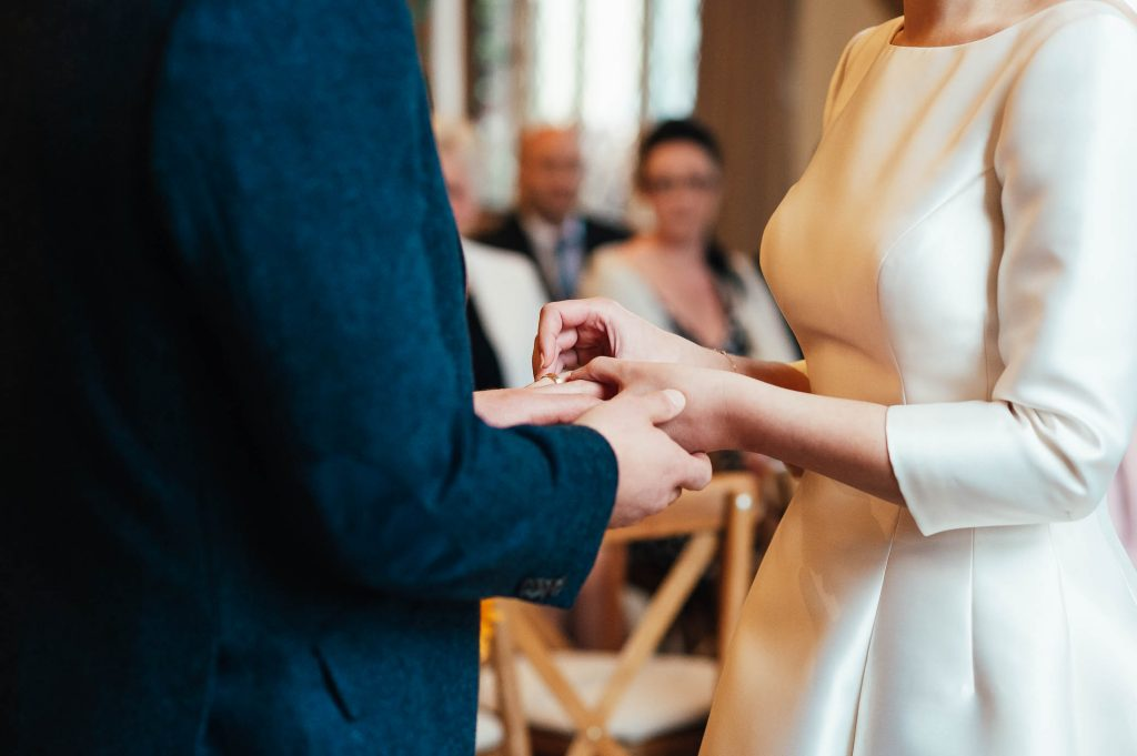 Ring exchange moment at Cain Manor wedding ceremony