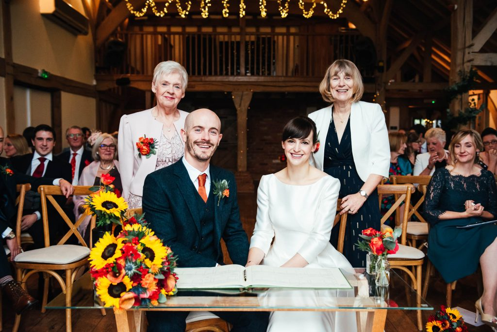 Couple share a photograph with their mothers after signing the registry