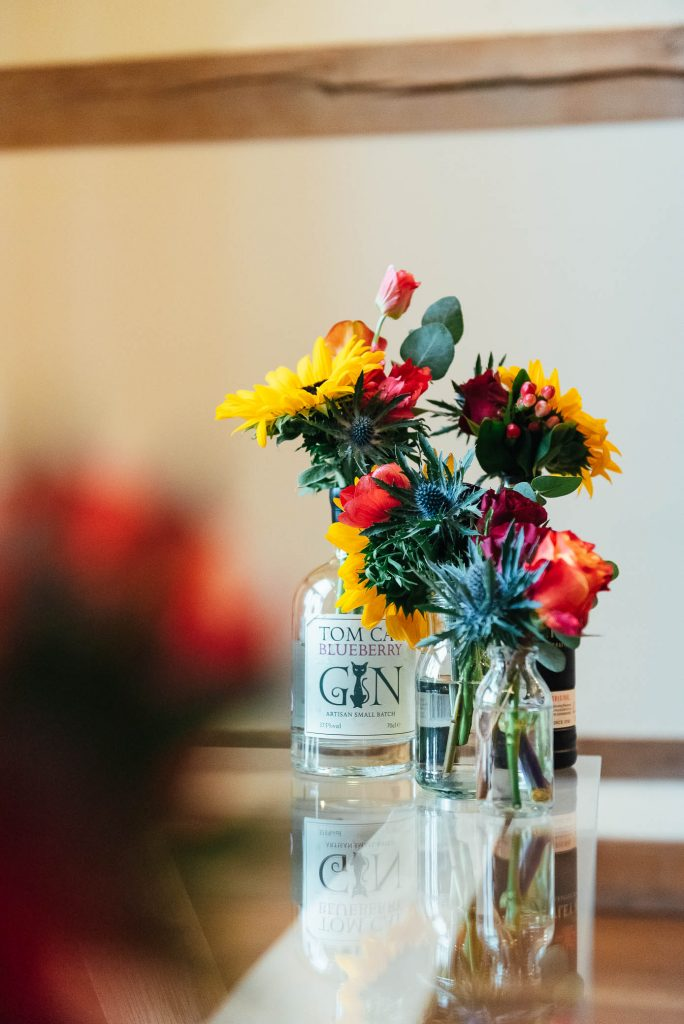 Autumnal florals in beautiful assorted gin bottles
