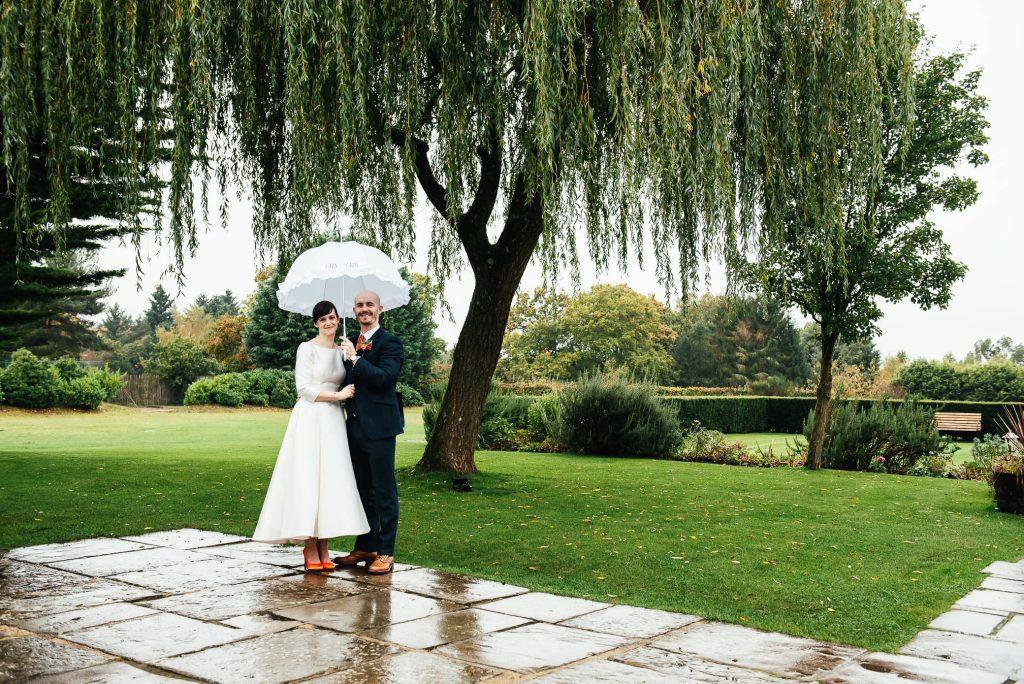 Rainy wedding day photography at Cain Manor