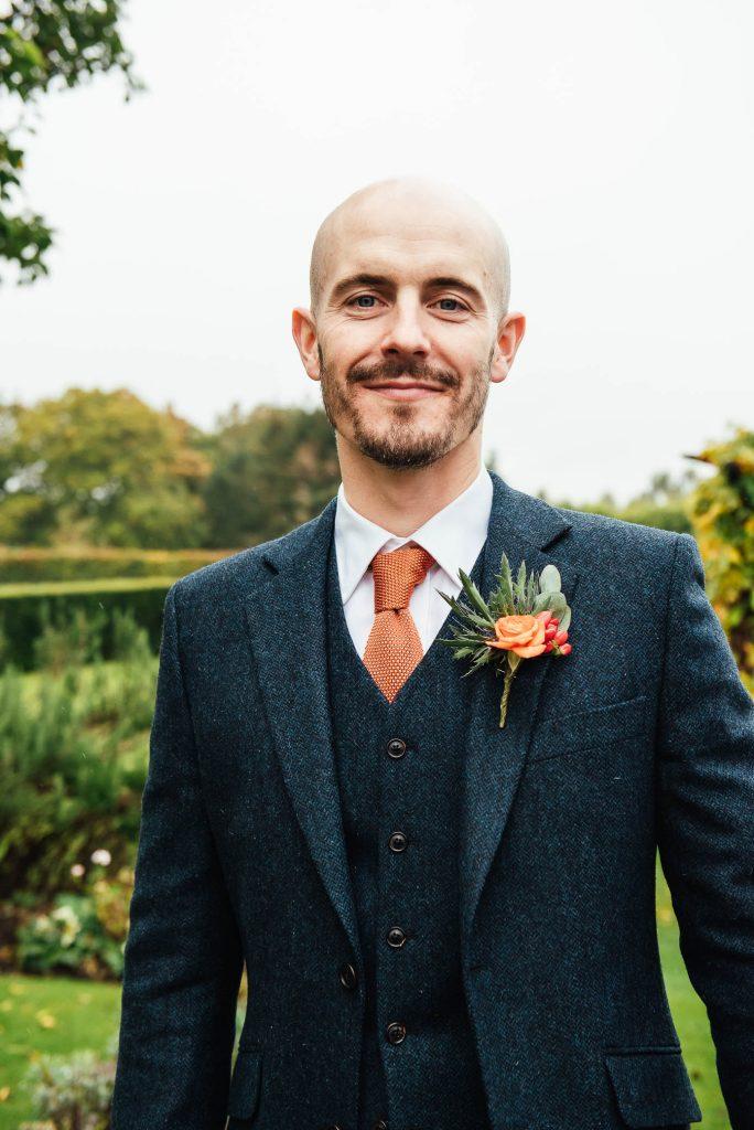 Handsome groom in Walker Slater Suit