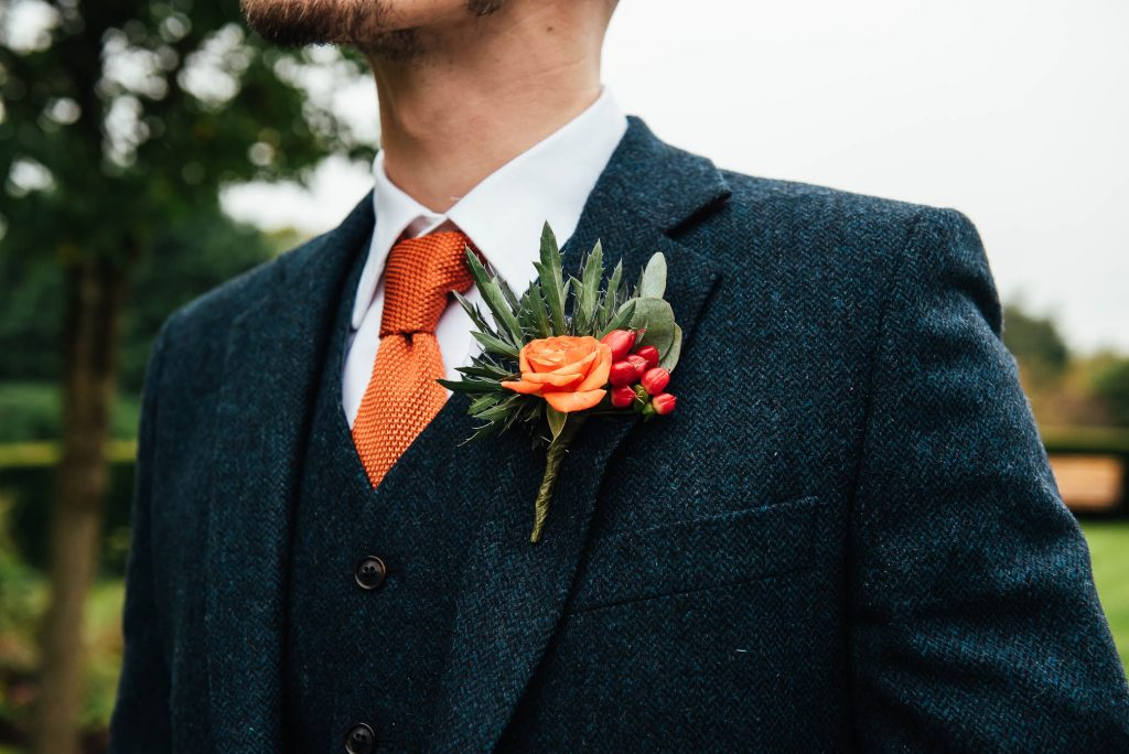 Autumnal button hole for Cain Manor wedding