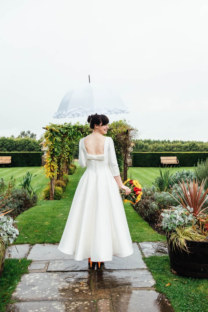 Beautiful bride in satin 3/4 length wedding dress