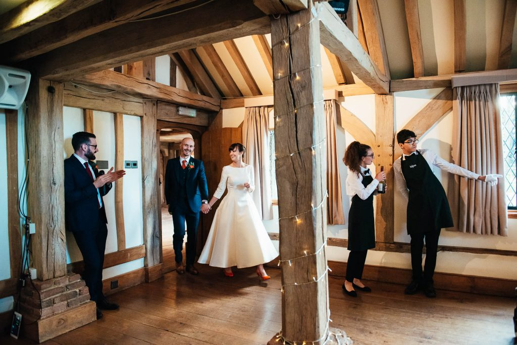 Bride and groom are announced into their wedding breakfast room