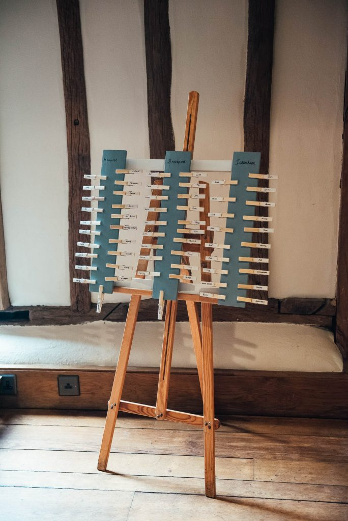 Handmade seating chart with painted pegs
