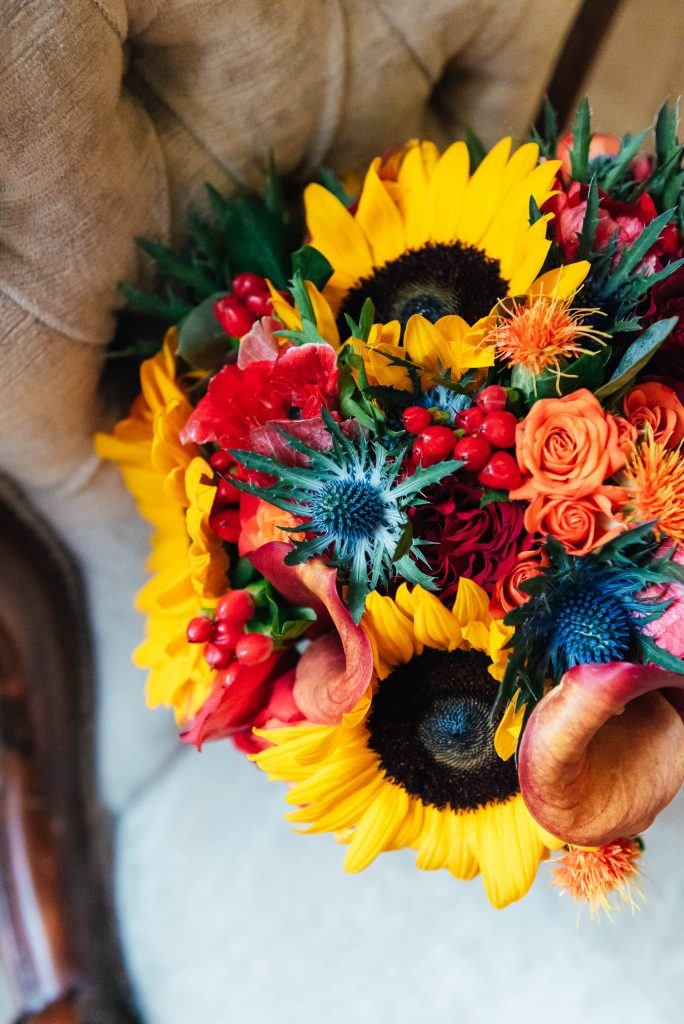 Autumnal Wedding bouquet filled with sunflowers, lilies and sea holly