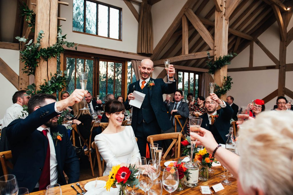 Guests toast during speeches Cain manor wedding