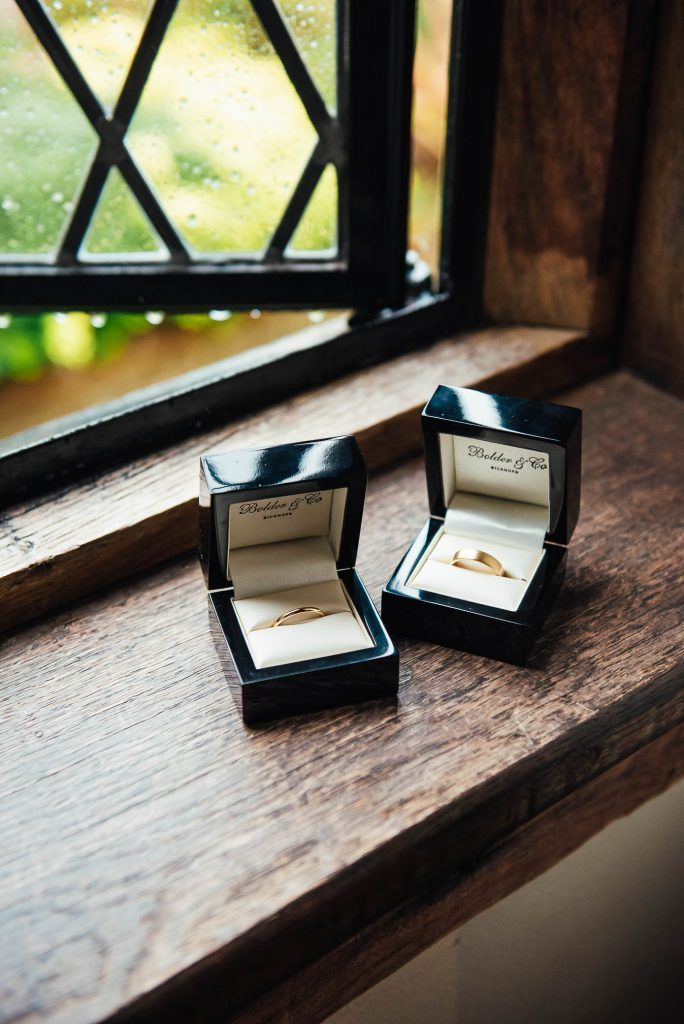 Wedding ring boxes perched on window sill