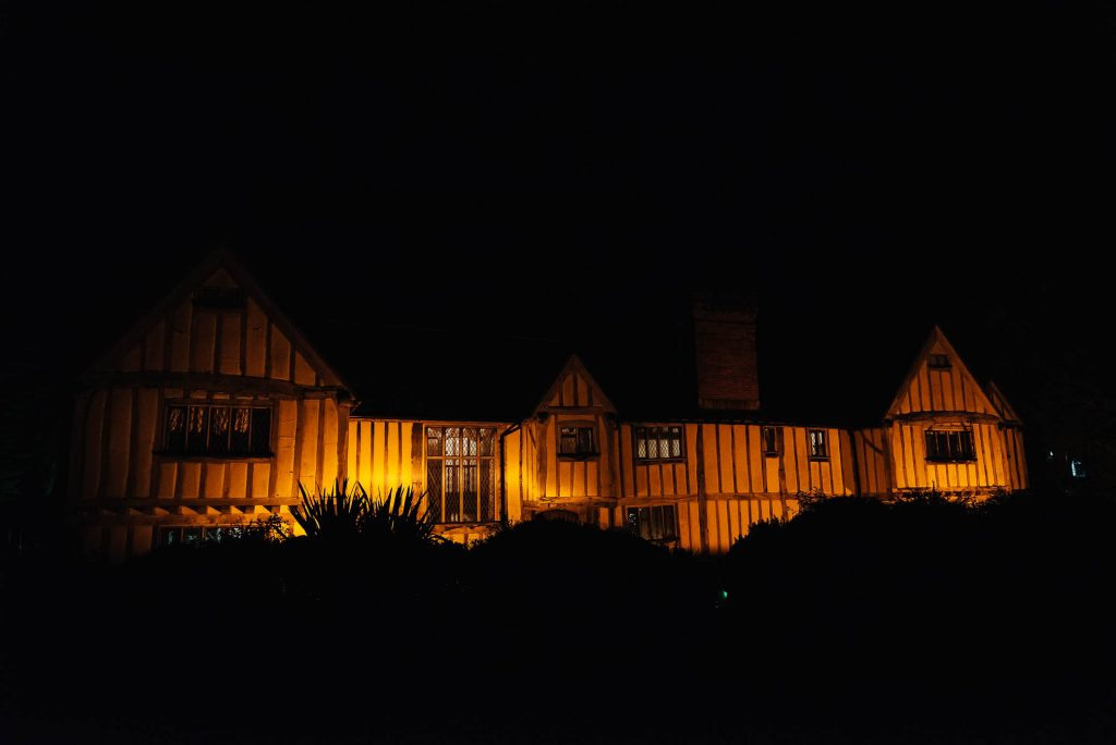 Night time portrait of Cain Manor at night