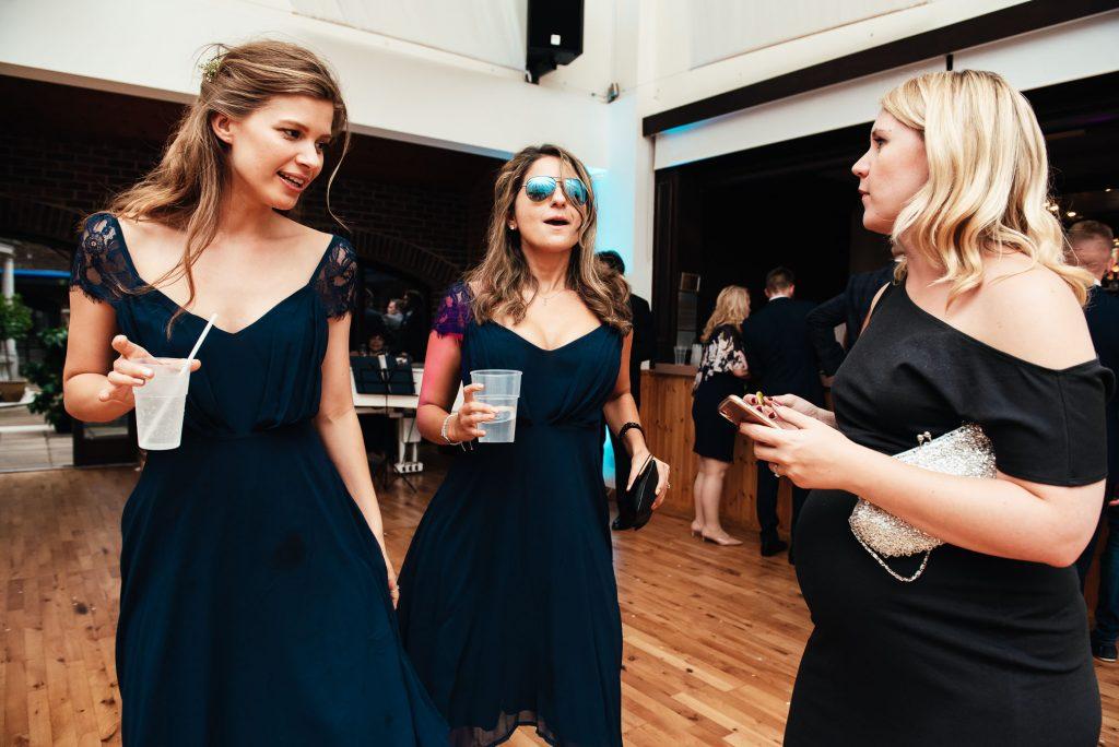 Bridesmaids dance together at Denbies wine estate wedding