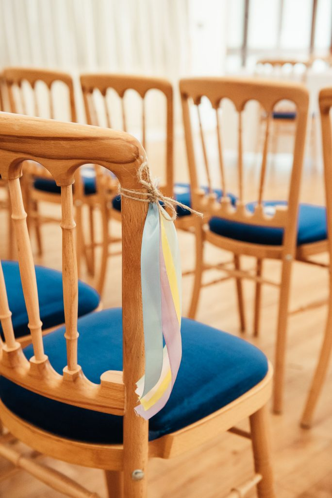 Pastel ribbons for chair decoration in the wedding ceremony