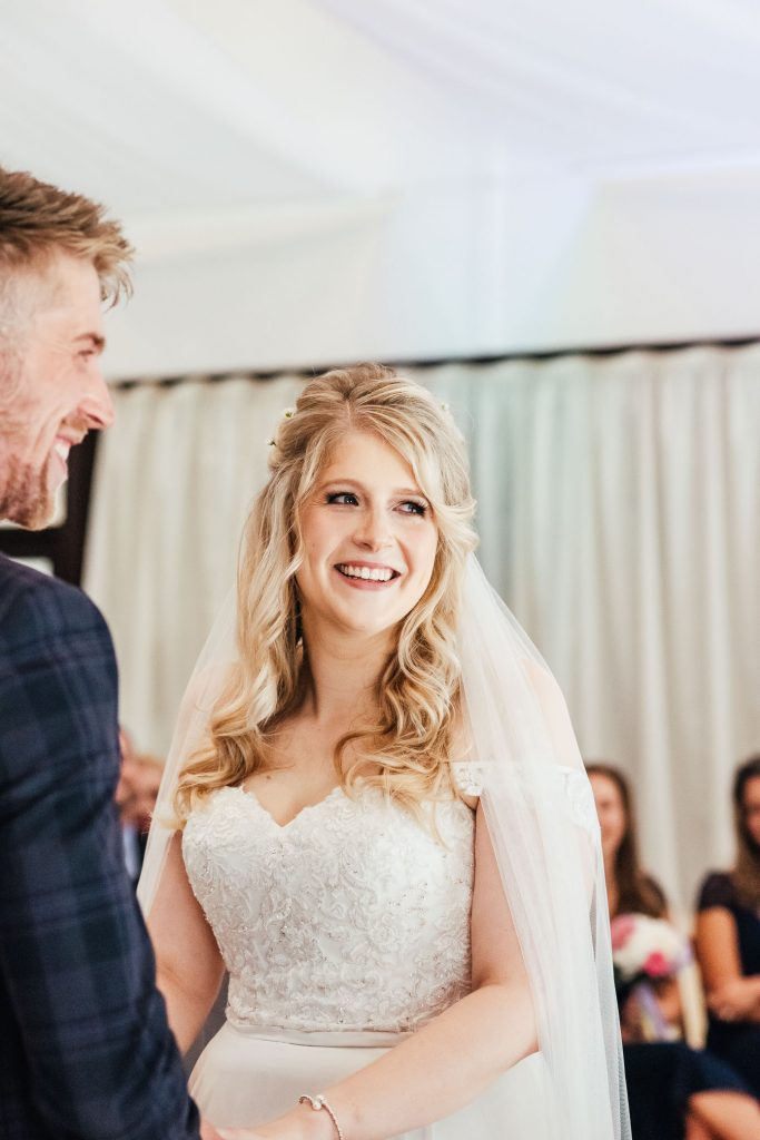 Candid reactions during wedding ceremony vows
