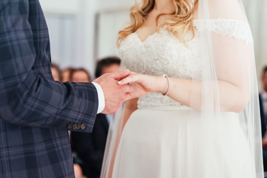Couple exchange rings during the ceremony vows