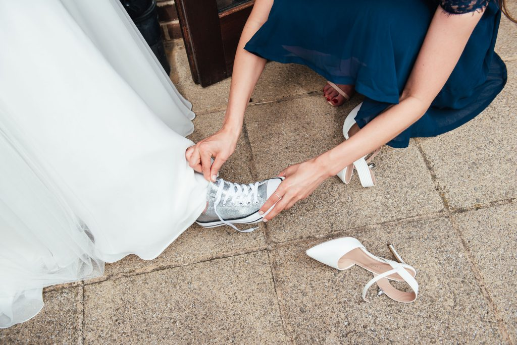 Bride changes into sparkly Converse during reception.