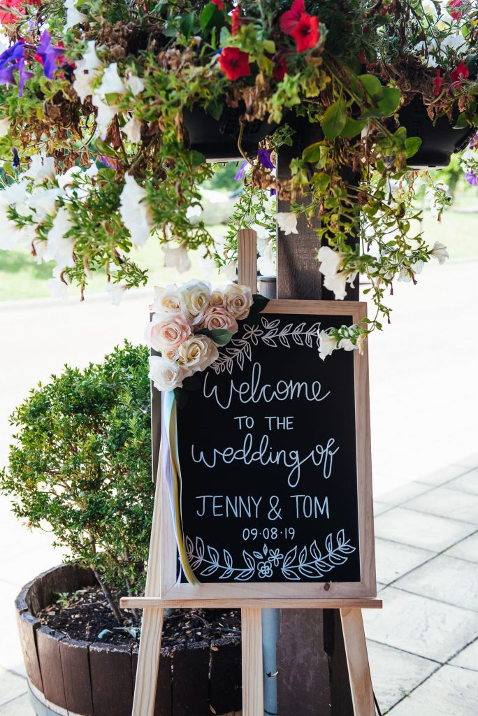 Bespoke wedding sign for relaxed Denbies Wine estate wedding
