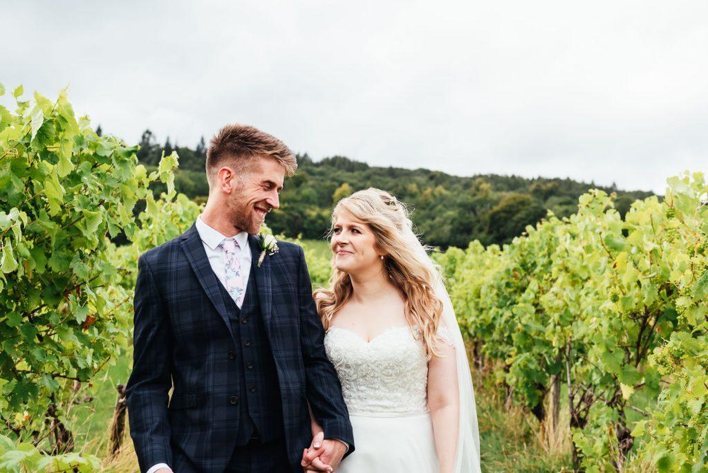 Relaxed outdoor couples portrait in Denbies Wine Estate Vineyard
