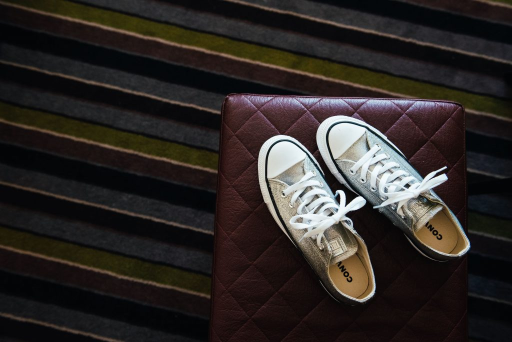 Sparkly white Converse wedding shoes for bridal preparation