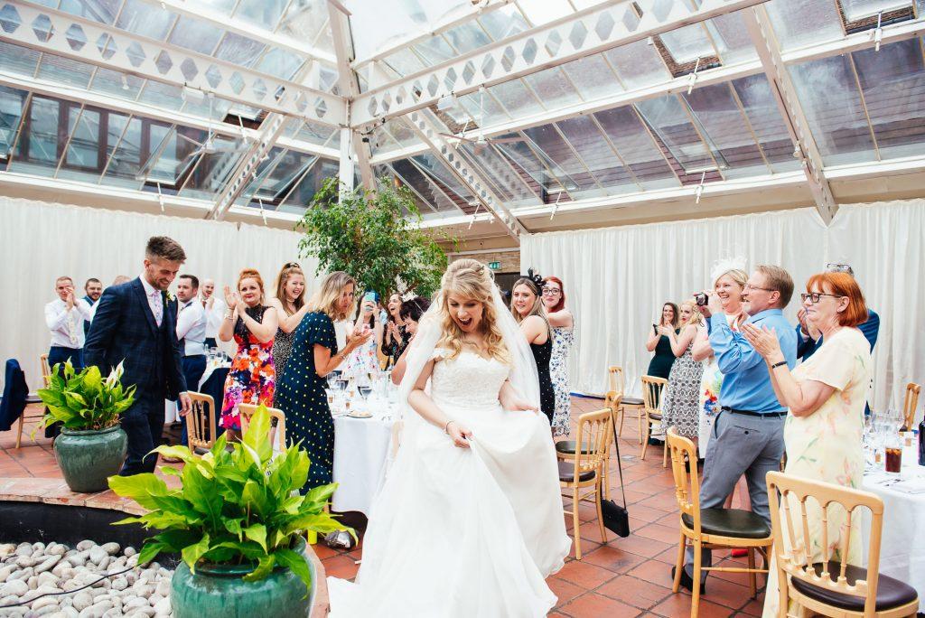 Bride and groom enter the wedding breakfast room together