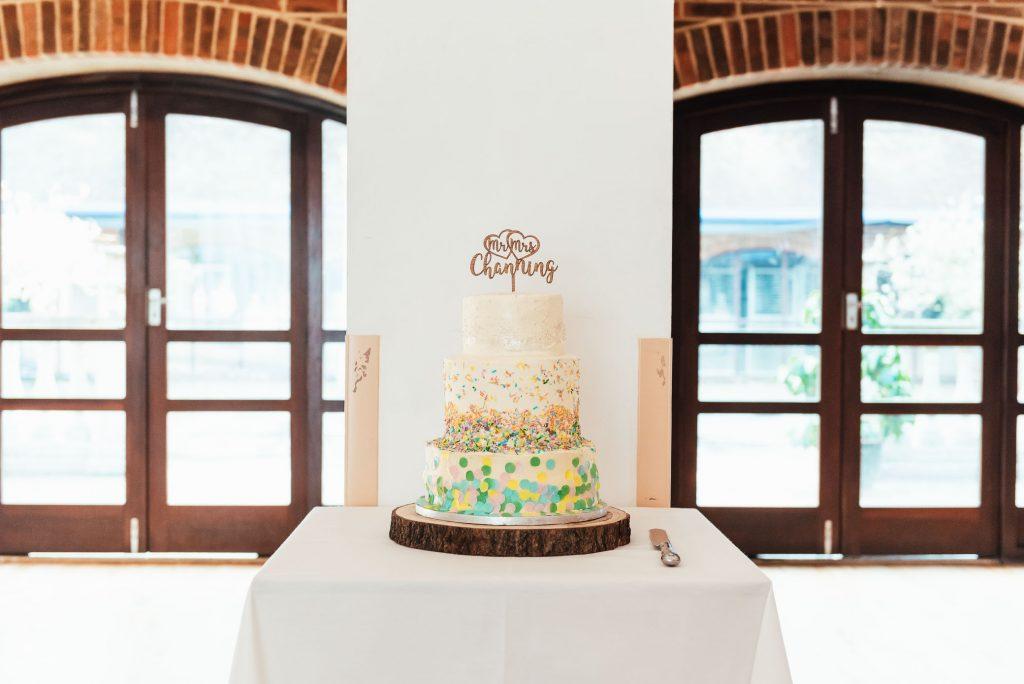 Three tier homemade wedding cake with confetti decoration