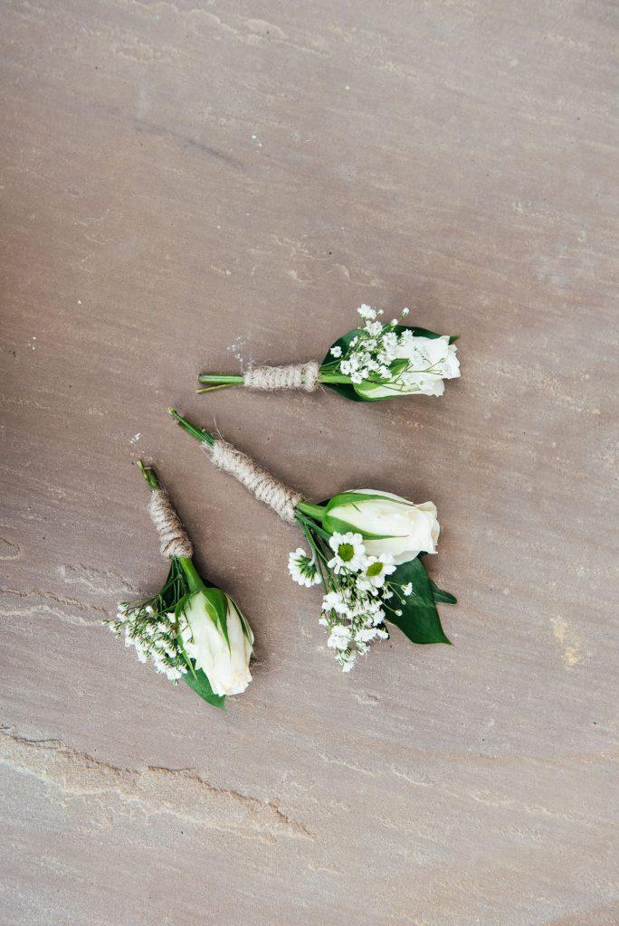 White button holes for Surrey wedding
