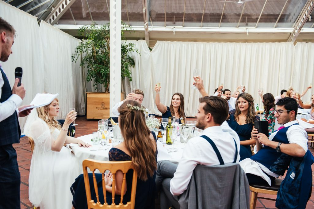 Wedding guests cheers together