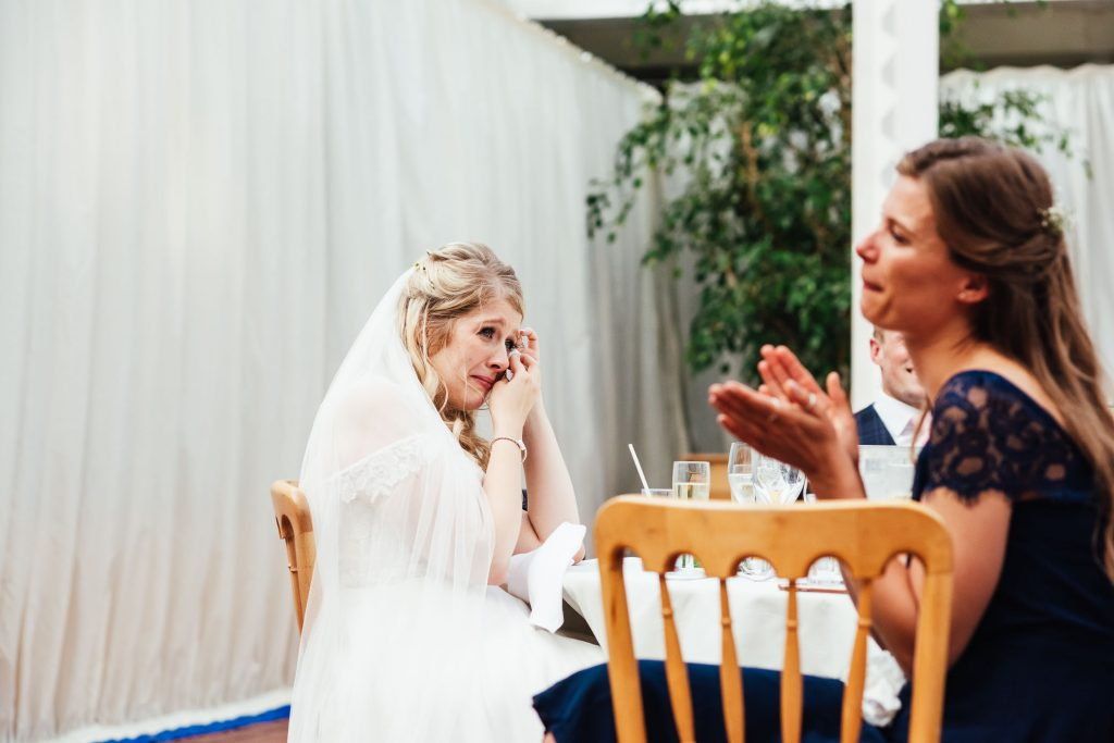 Emotional bride takes a moment during wedding speeches