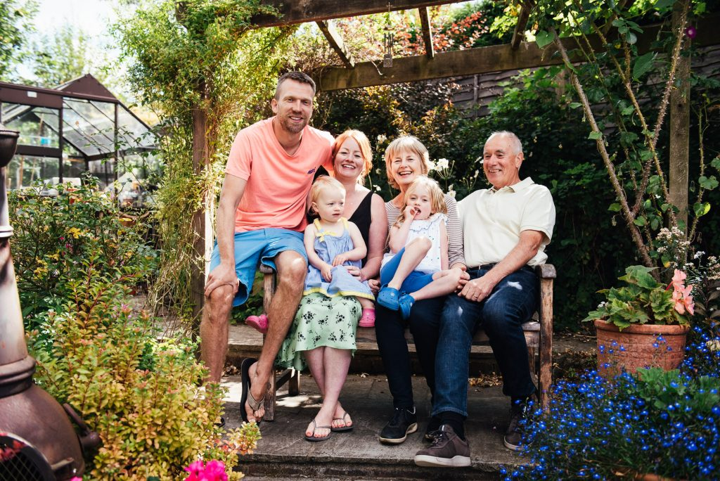 Natural family portrait at home in the garden