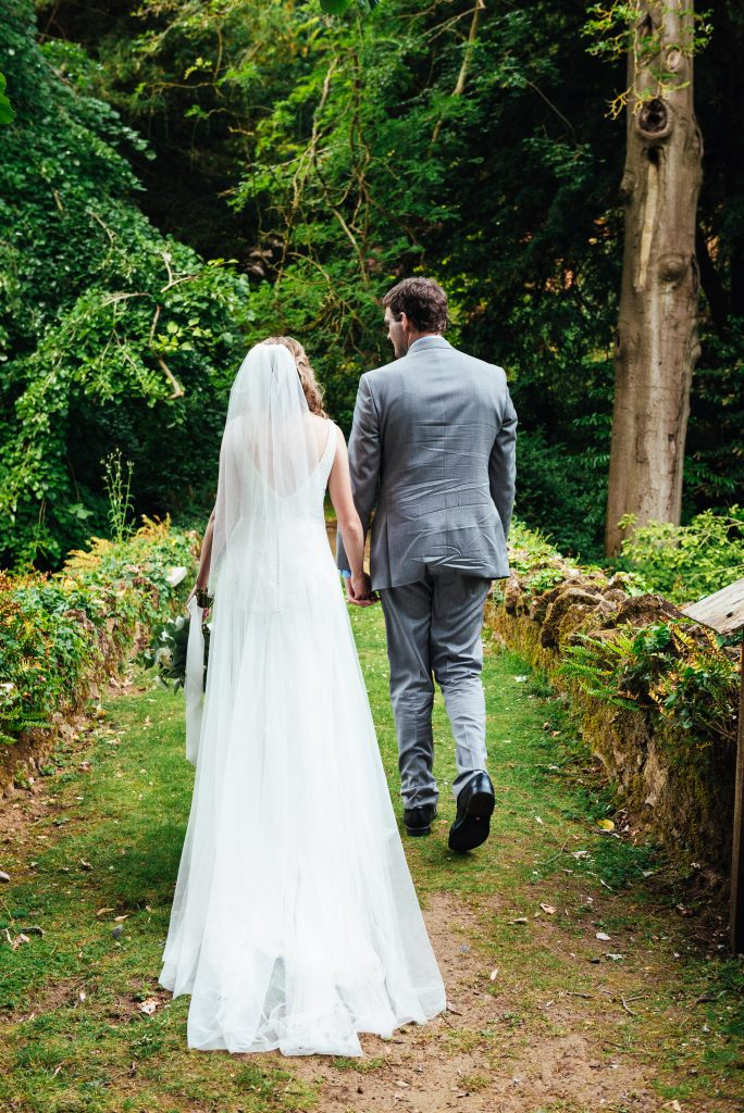 Bride and groom take a walk for Busbridge lakes wedding portraits