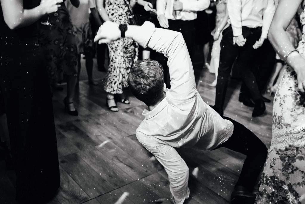 Fun dance floor photography, Busbridge Lakes Wedding