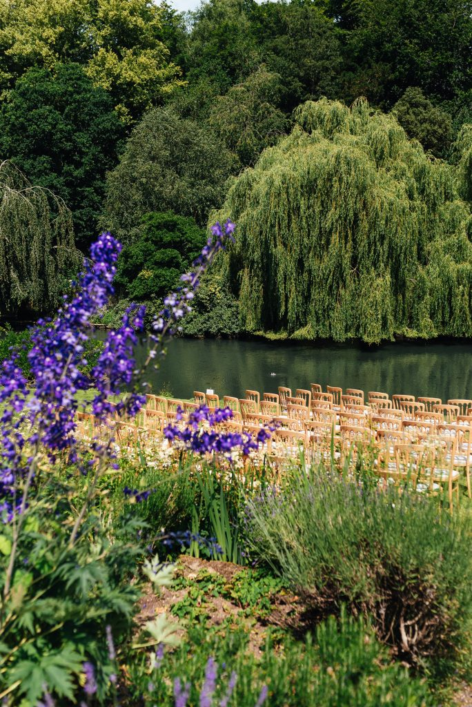 Outdoor wedding ceremony at Busbridge Lakes
