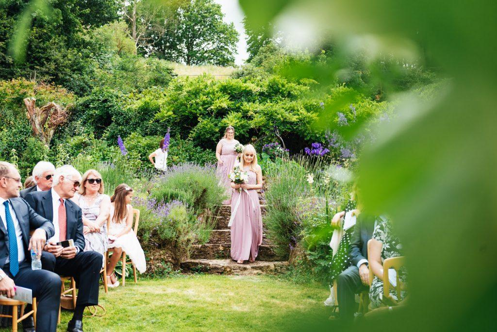 Bridesmaids Entrance at outdoor wedding ceremony