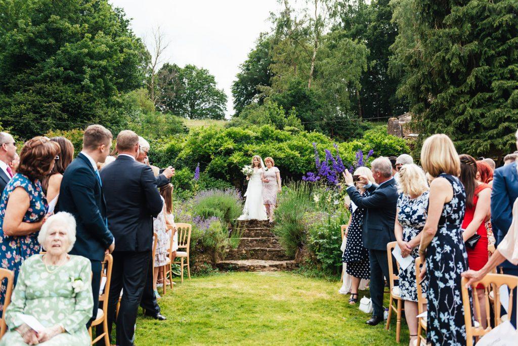 Entrance of the bride for outdoor wedding ceremony Surrey