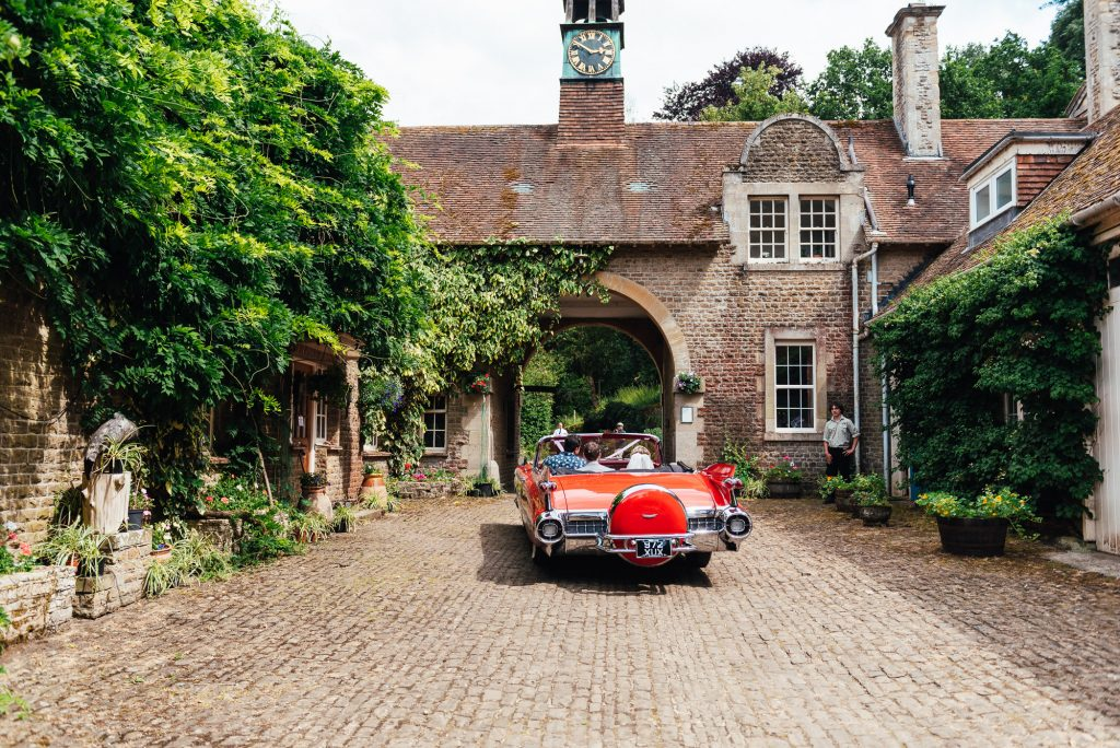 Wedding Couple Leave In Red Cadillac