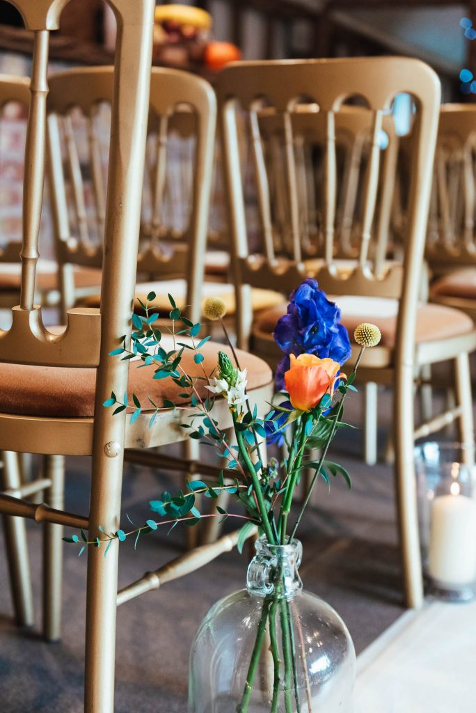 Colourful wedding flower arrangements for South Farm wedding