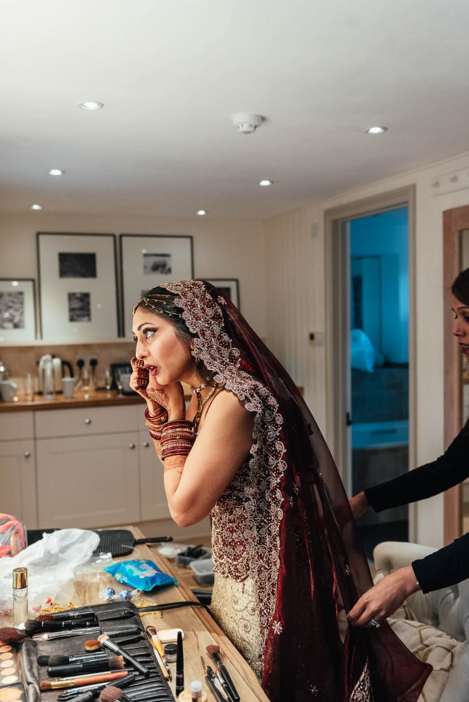 Final preparations for Indian bride on wedding day morning
