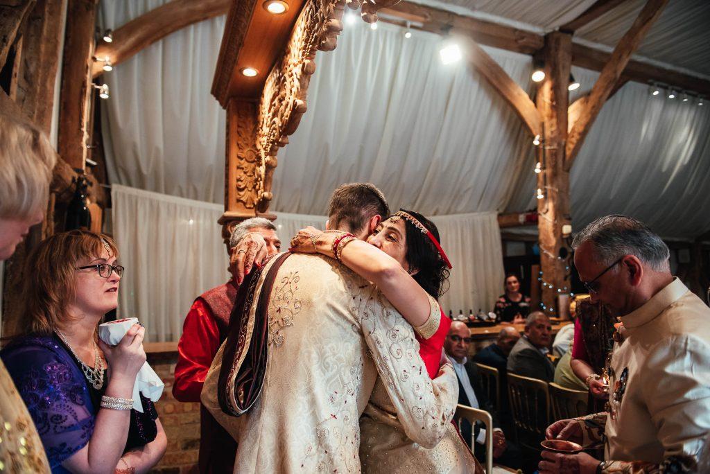Parents greet the groom in Hindu wedding ceremony