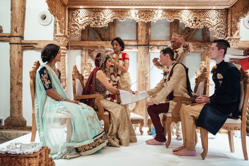 Wedding party sit under the Mandap, Hindu wedding ceremony