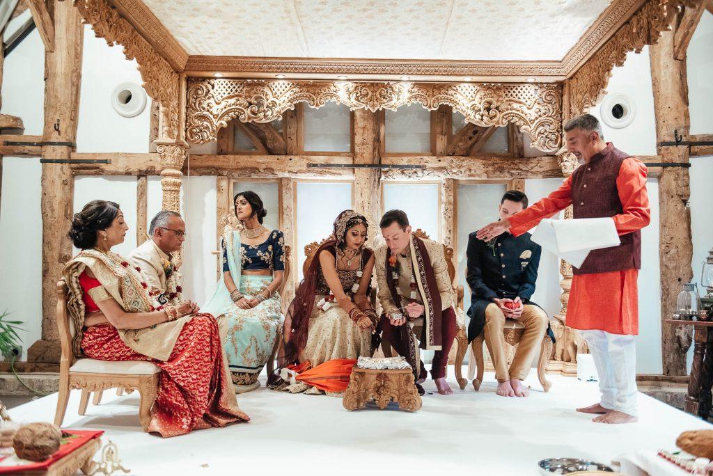 Bride and groom perform sacrificial fire ritual, Hindu South Farm wedding