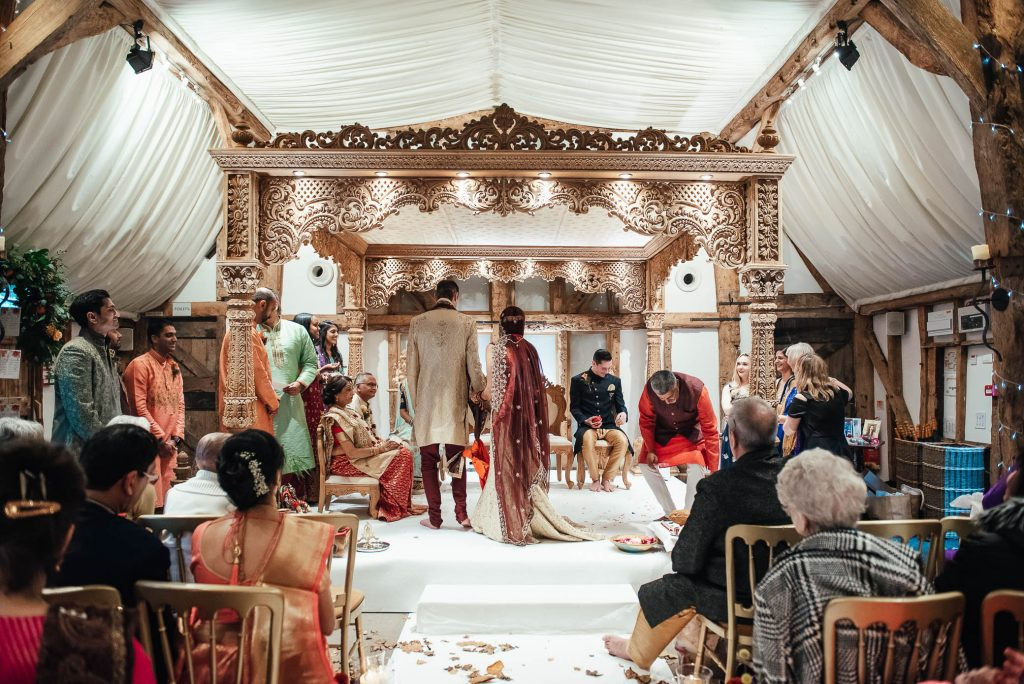 Bride and groom pass around the fire during Hindu wedding ceremony