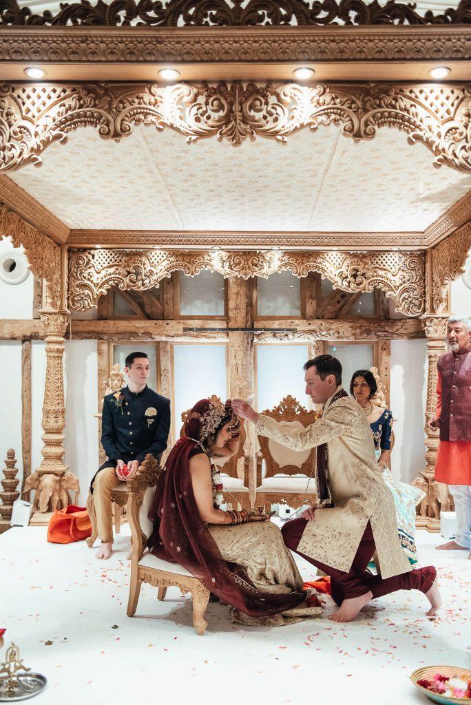 Bride and groom perform wedding ceremony rituals