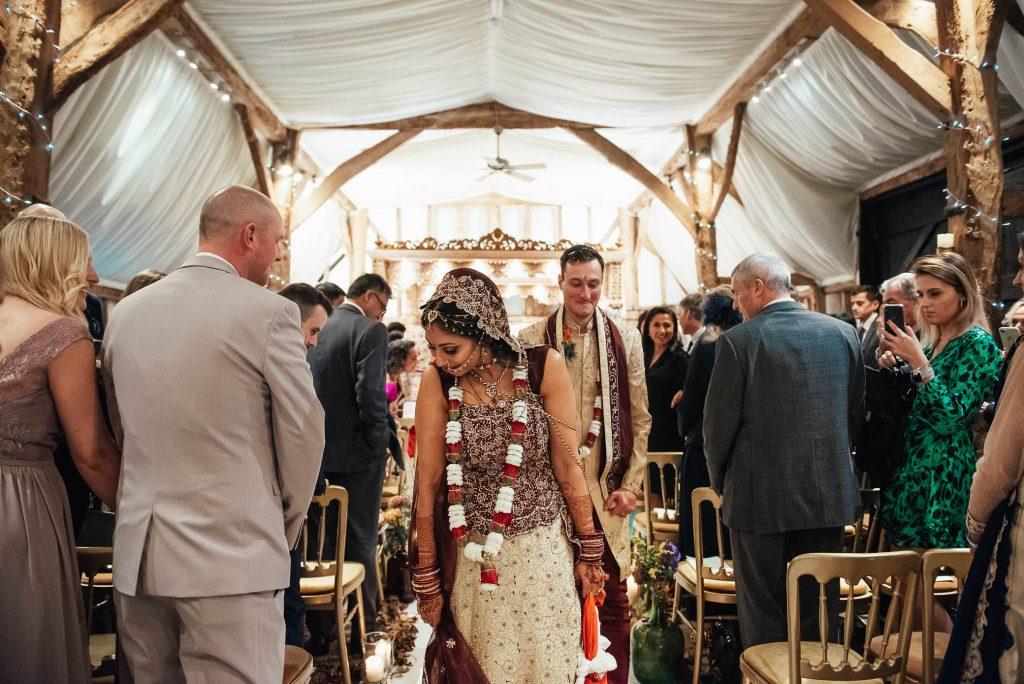 Newly married couple walk down the aisle together, South Farm Wedding